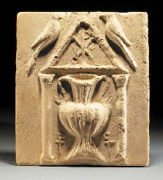 A BYZANTINE TERRACOTTA RELIEF TILE WITH BIRDS AND URN