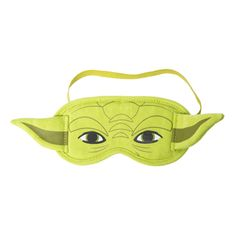 "<P>Put this sleep mask on and become the most powerful Jedi master of all. A green fabric sleep mask has the face of Yoda.</P><UL><LI>Elastic strap for a comfortable fit<LI>Measurements: 11 1/2""L x 3 1/2""H<LI>Materials: Fabric</LI></UL>"