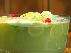 Lime Sherbert Punch                          * 2 quarts lime sherbert *2 liters ginger ale *1 (46 oz) can pineapple juice * lemon slices * lime slices * maraschino cherries
