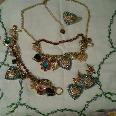 Betsey Johnson matching set of jewelry Selling as one necklace,  earrings,  bracelet and ring. Gold tone, teal blue, pink beads all set in pleasing pattern.  Selling special price for Valentines day. Brand new, tags were removed but never worn. Betsey Johnson Jewelry Necklaces