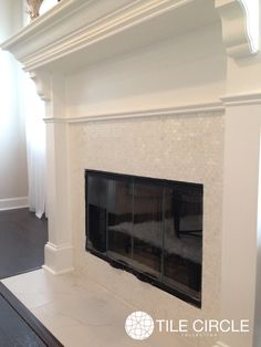 A unique and cozy fireplace with our white mother of pearl minibrick tile. Available at TileCircle.com