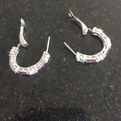 Sterling silver amethyst CZ earrings Beautiful genuine amethyst and cubic zirconia earrings, set in sterling silver, stamped 925 on the clasps. Jewelry Earrings