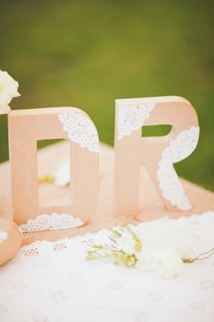 Standing letters with doilies/lace.