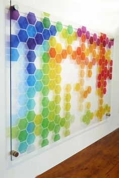 The shadowcasting of the individual hexagonal elements generates a three dimesional depth to this signarture 'chelsea' perspex artwork
