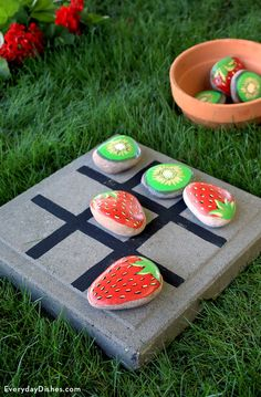 Although these strawberries and kiwi look good enough to eat, they're actually painted rocks for tic-toe-toe. Add a wood board on which to play and you've got an outdoor game that's easy to take anywhere.