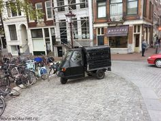 These small cars are one of reasons why I love Amsterdam.