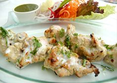 How to Make Murgh Malai Tikka, English / Urdu Recipe  Chicken Leg, Boneless12 pcs Garlic ginger Paste – 2 tbsp White Pepper Pd – 2 tsp Salt  Melted Butter for Basting Clean the chicken leg boneless pieces and cut them into two. Rub with Ginger garlic paste, pepper and salt and keep aside for 20 minutes. Marinade:  Egg – 1 Grated Cheddar Cheese – 2 tbsp Chopped Green Chilli – 4 Chopped Coriander Leaves – 1 tbsp Cream – 180ml Mace powder – ¼ tsp Nutmeg powder – ¼ tsp Corn flour – ½ tbsp