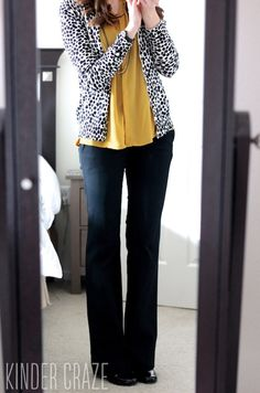 Add a printed layer over a mustard blouse to add interest to a classic look.