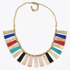 Instantly make any outfit more fun with the funky-fabulous Chroma Fan necklace.  This bold statement necklace features bright jewel-tone colors and golden accents shining like rays of rainbow light from your beautiful face!