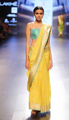 By designer Swati and Sunaina. Shop for your wedding trousseau, with a personal shopper & stylist in India - Bridelan, visit our website www.bridelan.com #Bridelan #swatiandsunaina #swatiandsunainasari #lakmefashionweek