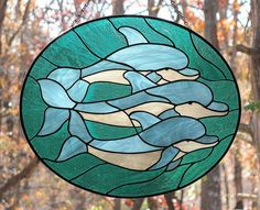 Stained glass dolphins oval suncatcher panel by livingglassart home of oddballs and oddities, via Flickr