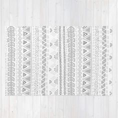 Buy Area & Throw Rugs with design featuring Grey aztec pattern by Roxy Leaver and adorn your home with both style and comfort. Available in three sizes (2' x 3', 3' x 5', 4' x 6').