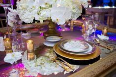 Trending at The Ritz-Carlton, Atlanta are modern menu designs coupled with antique decor like round, translucent menus over brass dinnerware.
