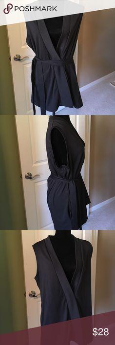 """Susan Graver Long Black Vest w/belt has pockets Susan Graver """"M"""" long black vest with one snap, belt and pockets, tunic length covers rear. Versatile Susan Graver Jackets & Coats Vests"""