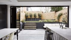 A dream backyard opens seamlessly to the I indoors.  I'm not one for sprawling lawns, although a view of the forrest would be divine. But b...