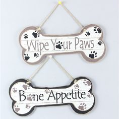 "These bone signs are a cute way of showing some puppy love in your home. The ""Bone Appetite"" sign makes a great decoration for your kitchen, while the ""Wipe Your Paws"" sign provides a friendly reminde"