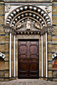 Wonderful massive wooden doors from Pistoia, Italy... <> Pistoria was the center of Gallic, Ligurian, and Etruscan settlements before becoming a Roman colony in the 6th century BC. Its most splendid age began in 1177 when it proclaimed itself a free commune. In following years it became an important political centre, erecting walls and several public and religious buildings such as the large Piazza del Duomo. Today it is also notable for beautiful extensive garden nurseries.