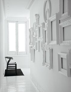 Madrid-born and Miami-based designer and architect Nacho Polo  Love this picture frame wall