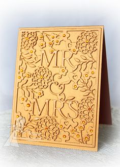handmade card ... die cut coverplate with MR & MRS, flowers, hearts, and foliage ... gorgeous look of embossing with tone on tone gold paper... some bling on flowers ... two layers of die cust used to make design deeper ... perfect for weddings and anniversaries ...