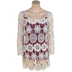 Beautiful crocheted cream-colored tunic by Tasha Polizzi.  We love how versatile this piece can be! Think swim suit cover-up, over your favorite tank and leggings or even to jazz up that little black dress!