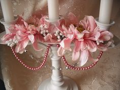 buy candle holders  paint them.. hot glue plates on top with a holder in middle for a candle or clear wine glass..put clowers inside glasses ..then add flowers & pearls/crystals, to plates too..etc.candleabra wedding centerpiece bridal decor