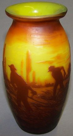 MULLER FRERES CAMEO GLASS VASE. Cut orange to yellow, with figural and animal in field decoration