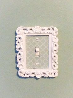 Wanting to do something similar to a double switch I have. Framed Light Switch Cover by StitchesandThrows on Etsy, $10.00