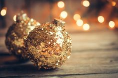 Golden christmas ornaments on rustic background by Alena Haurylik / Christmas Mood, Noel Christmas, Christmas Colors, Christmas Photos, Christmas Bulbs, Christmas Decorations, Wallpaper Natal, Christmas Wallpaper, Rustic Background