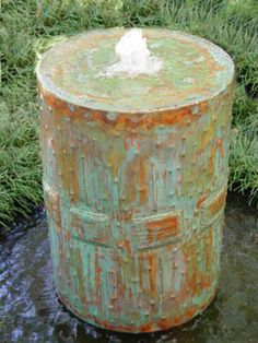 barrel water fountain is one of simple and cheap garden decorations