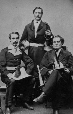"""Photo of three chiefs of the Lansing (Mich)  Fire Department. From left, Tom Wescott, Alex Cline, and Ned Burton or Mr. Bonner. Chief Wescott was one of the founders of the Lansing Fire Department in 1857, elected """"chief engineer"""" June 17, 1872; also a charter member of the Grand River Boat Club in the same year."""
