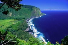 """Located on the northern Hamakua Coast, the sacred Waipio Valley was the boyhood home of King Kamehameha I, and an important center for political and religious life in Hawaii. Not only is """"The Valley of the Kings"""" an important site for Hawaiian history and culture, it's also a place of dramatic tropical beauty."""