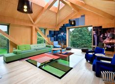Balancing Barn - Interior - The glass section of the living floor plays to the 'gravity' theme of this holiday home.