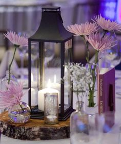There's a lot to love on this rustic vintage centerpiece: the lantern, wood coin, medicine bottles, mercury candle holders and the vintage book used as a table number.   #lanterns, #centerpiece  Photography: Mel & Co. - melbarlowandco.com Event Planning, Floral + Event Design: DM Events Planning and Design - dmeventsny.com  Read More: http://stylemepretty.com/2012/04/10/crescent-beach-club-wedding-by-dm-events-planning-design/