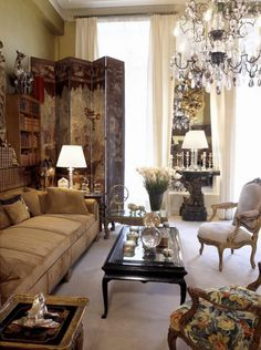 31 Rue Cambon, the apartment. Coco Chanel believed in the healing power of crystal. She had this chandelier custom made. GABRIELLE 'COCO' CHANEL'S APARTMENT. While journalists visited Coco in the salon, it also hosted many of her famous friends such as Elizabeth Taylor, Salvador Dali and Pablo Picasso. Coco designed this couch herself.  Normally people used silk or velvet, but Coco used suede, which was very cutting edge.