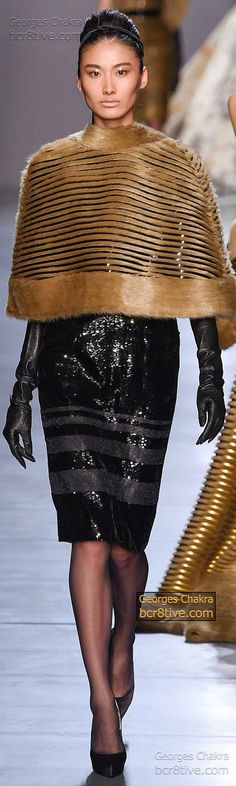 Striking Black Sequin Dress and Gold Cape