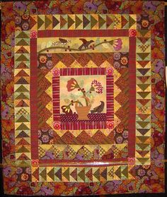 """Was That a Berry?"" by Kathleen Bond, Mountain Top Quilters (Arizona).  She says: ""I hand appliqued the center using a Jan Patek pattern. I got the inspiration for all of the rows from antique quilts.  Kaffe Fassett fabrics always involve some fussy cutting"".  Photo by Quilt Inspiration; 2011 AQG show."