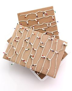 """""""Storing Christmas Lights:  Next year, don't spend a minute sorting through tangled webs of holiday decorations. Keep lights organized by winding each strand around a piece of cardboard cut to fit in a plastic bin (our pieces were 20 by 14 inches). Use scissors to cut a 1-inch slit at the top of one long side and the bottom of the other long side of the cardboard. Secure one end of the lights in a slit, wind lights around, and secure the other end in the other slit. Store stacked light…"""