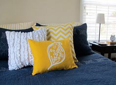 Navy and yellow for Oaken's half of the bedroom