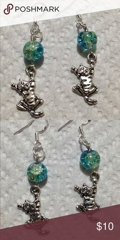 Blue and Green Kitty Cat Earrings These cute earrings are made with duotone green and blue glass beads. The hooks are sterling silver. All PeaceFrog jewelry items are made by me! Take a look through my boutique for coordinating pieces and more unique creations. PeaceFrog Jewelry Earrings