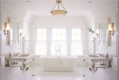 An alabaster light fixture crowns the master bath in an 8000 square-foot