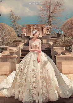 Blending 3D floral appliques with a classic silhouette, this wedding dress from Bella Wedding Dress is a show stopper!
