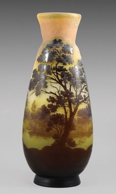 ✨  GALLÉ CAMEO GLASS - LANDSCAPE VASE c. 1910 Three layers of glass in green and brown etched to depict a lake landscape on a white and yellow background. Cameo mark Gallé™. Estimate $5,000 – $7,000