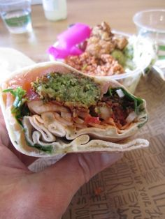 Falafel sandwich with smoked salmon, eggplant, pickled fennel, tomato ...