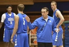 Duke coach Mike Krzyzewski talks to the team as freshmen Brandon Ingram, left, and Luke Kennard, second from left, and senior Marshall Plumlee line up for another drill during Friday's practice.
