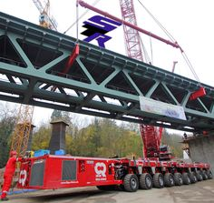 Problem-free installation of a 355-tonne bridge  The procedure in replacing a complete bridge is often accompanied by a complete closure of the structure - delays in the process can easily become very expensive.  More http://link.in/pnne7  #Scheuerle #TII #Rige_Mainz #Germany #SPMT #railway #bridge
