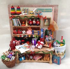 Miniature Christmas Workshop wrapping gifts workbench - Dolls House 1/12th scale on Etsy, $165.00