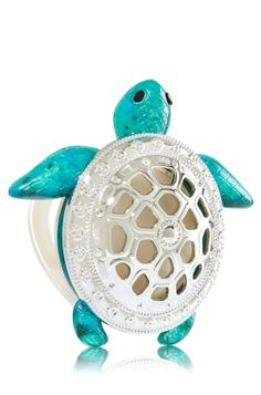 Tortoise - Scentportable Holder - Bath & Body Works - A shiny openwork shell adds a fancy touch to this tortoise! Pair holder with your favorite Scentportable Refill to radiate fragrance into your car without a plug, battery or flame. The built-in clip base attaches to your visor or seat pocket for a scent-sational driving experience.