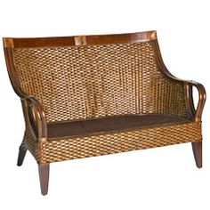 Rattan and pinewood settee...can see it with cushion in sunroom. $399.95