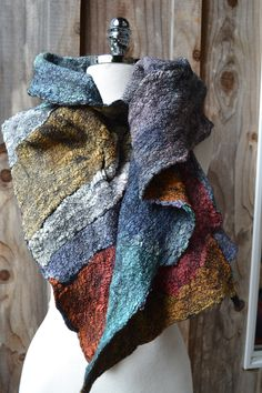 hand dyed silk, felted onto black wool, made by Tash Wesp