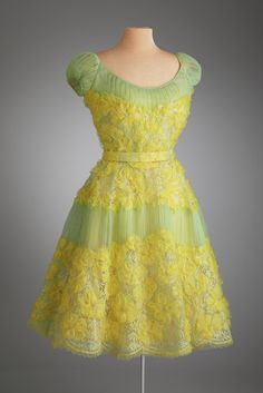 Dinner dress, Oldric Royce, Inc., New York City, ca. 1960, Yellow silk acetate, nude silk organza, green net. Photo by Renee Comet/Courtesy of Hillwood Estate, Museum and Gardens